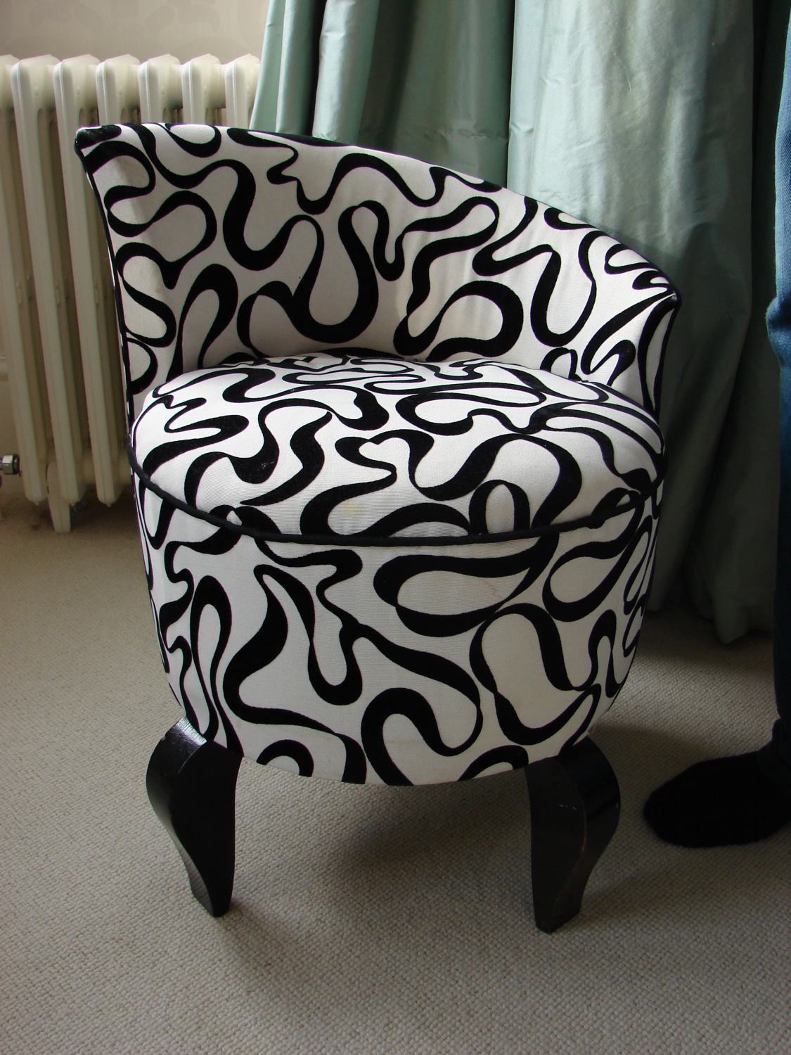 An Art Deco stool in original fabric