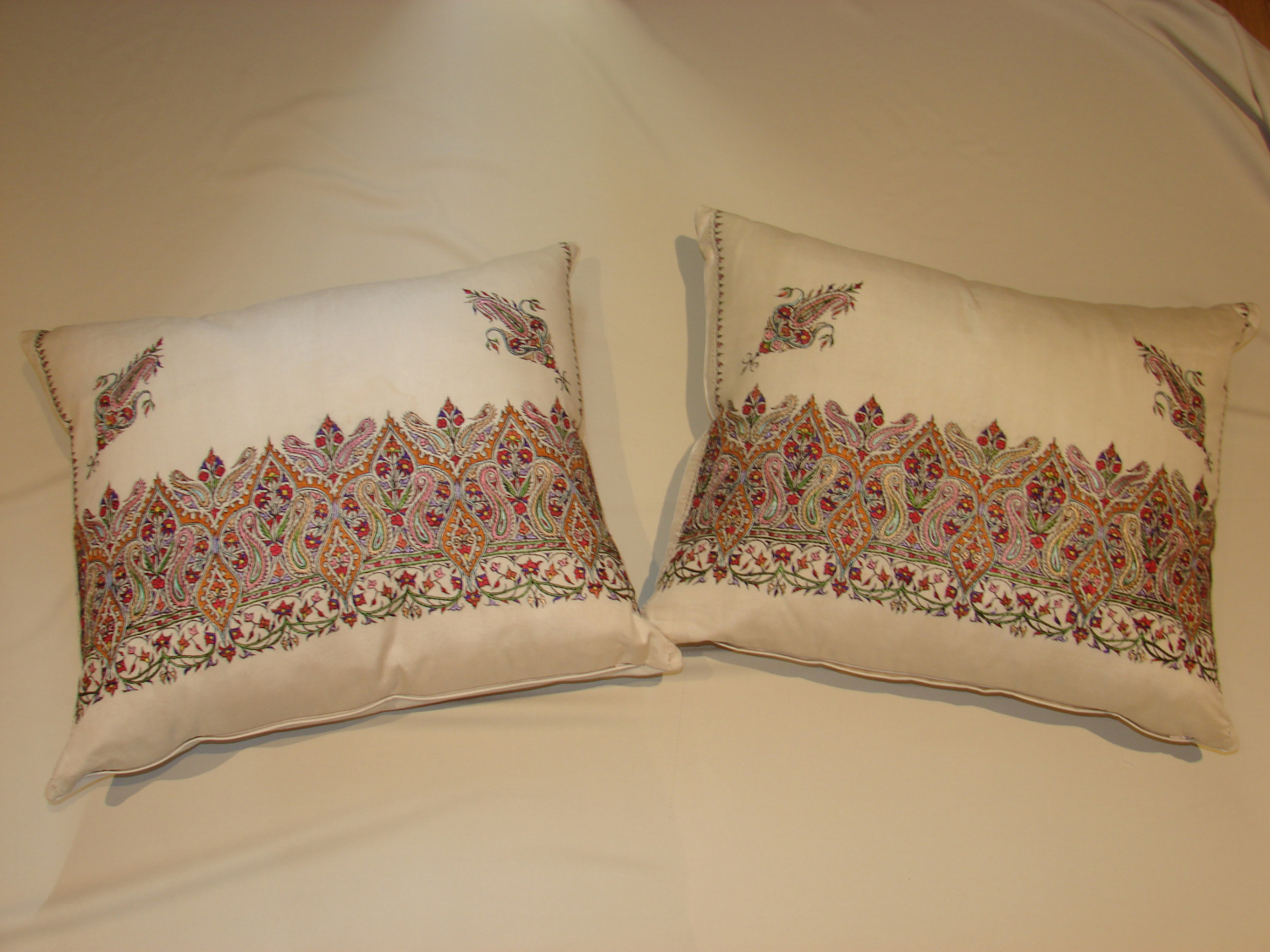 Pair of cotton embroidered paisley cushions