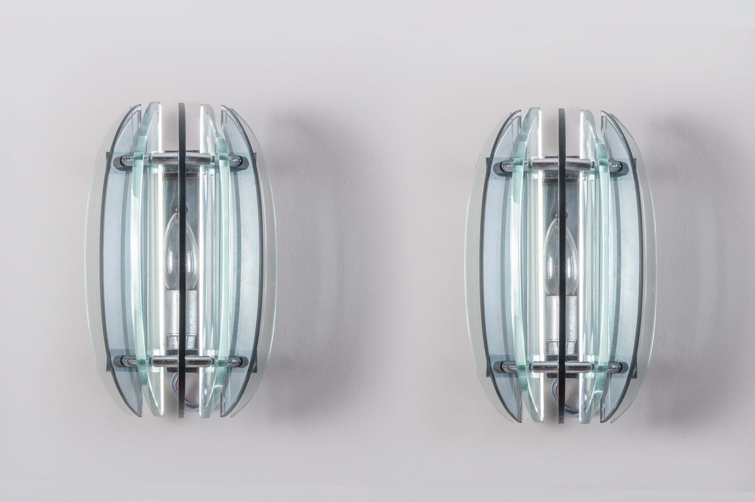 Pair of black/ clear glass wall sconces