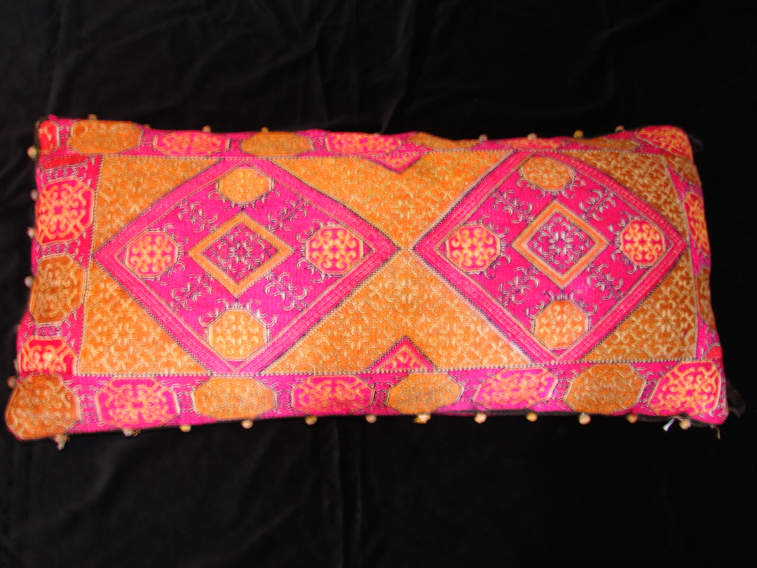 A vintage embroidered Afghan wedding pillow