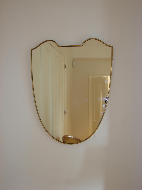 Shield shaped 40`s brass framed Italian mirror