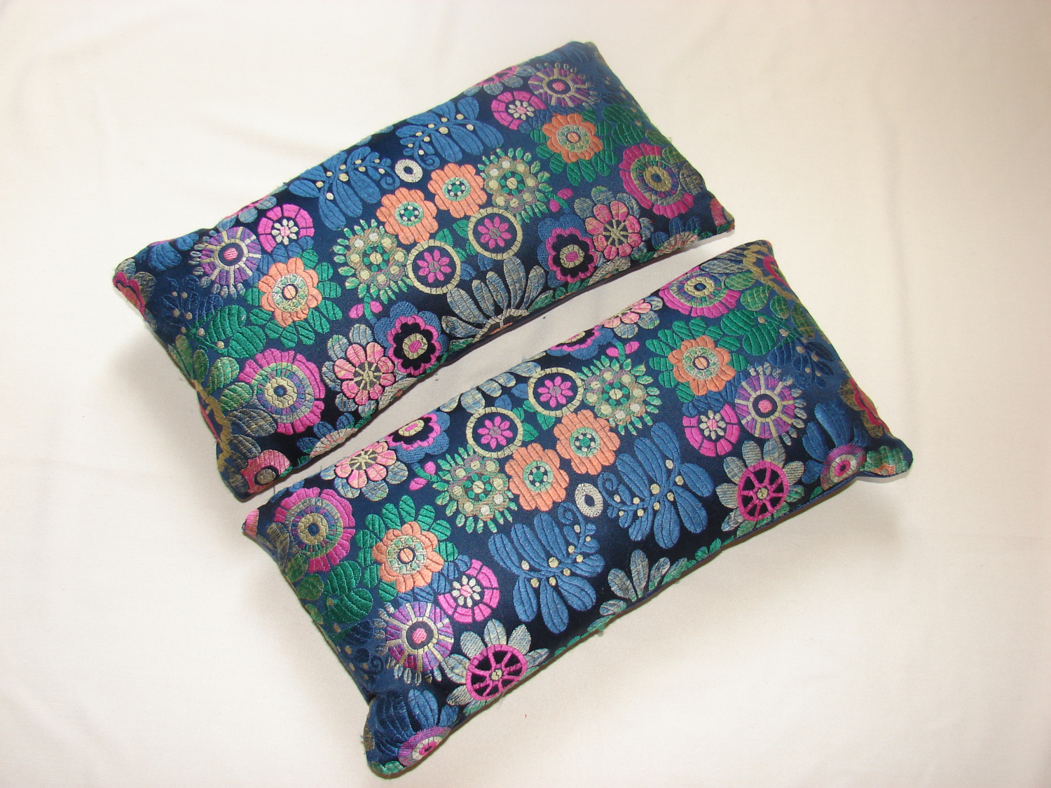 A pair of 60`s floral silk lavender cushions