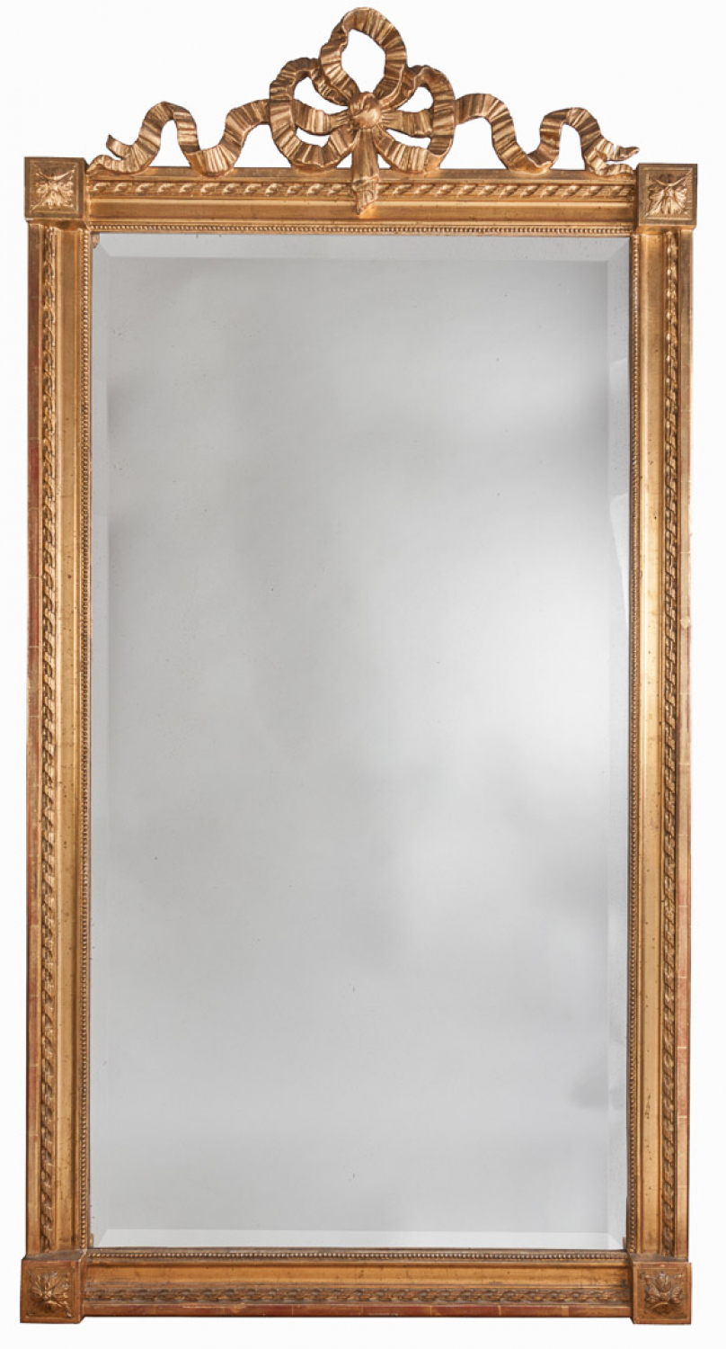 Ribbon-crested gilt wood mirror