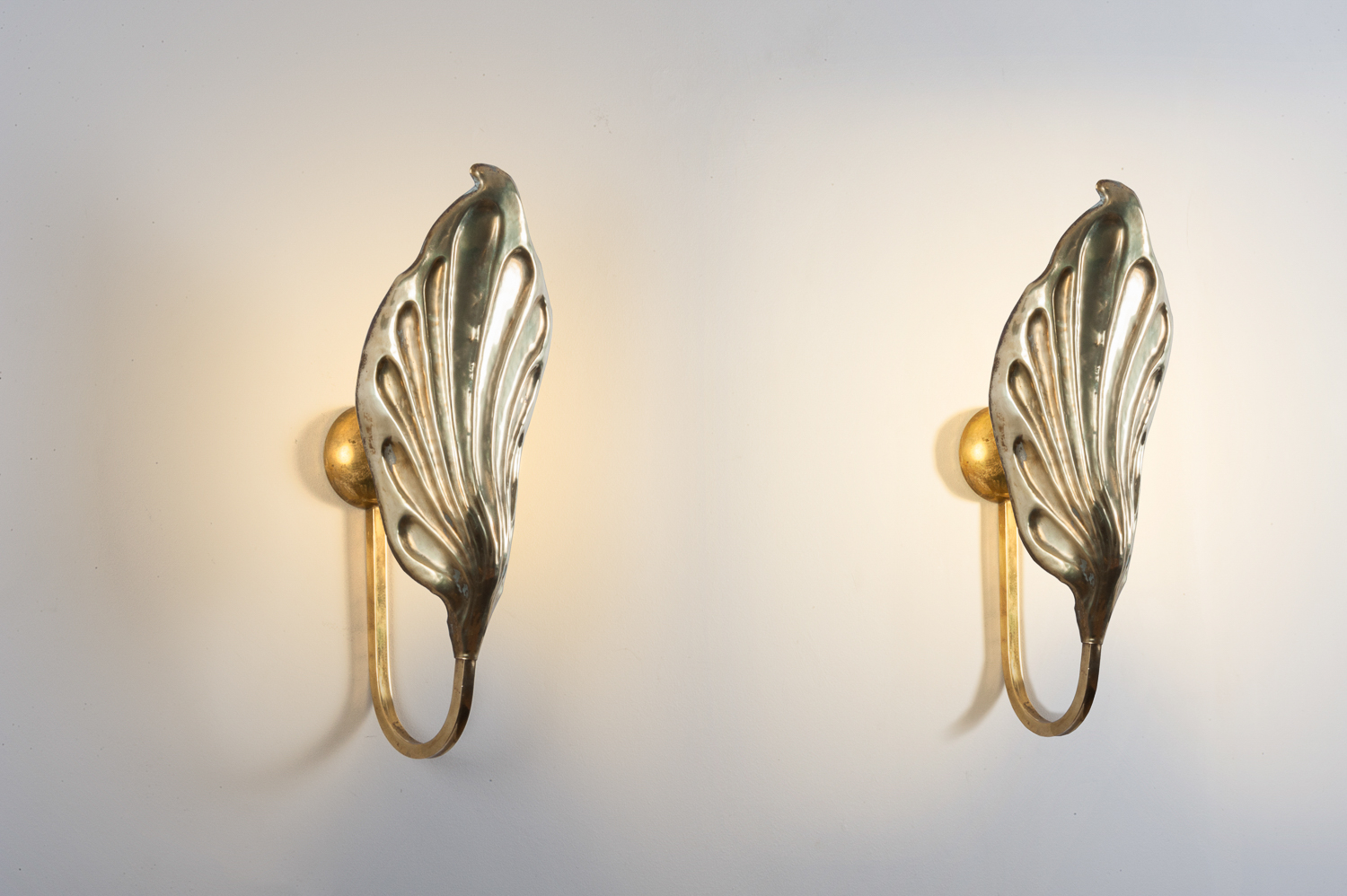 Pair of brass wall lights by Bottega Gadda