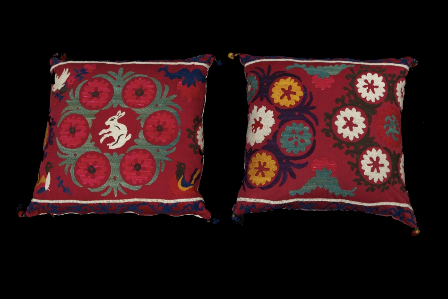 A pair of mid 20th Suzani cushions
