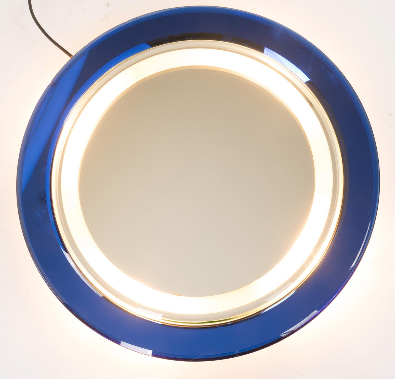 Illuminated blue glass mirror