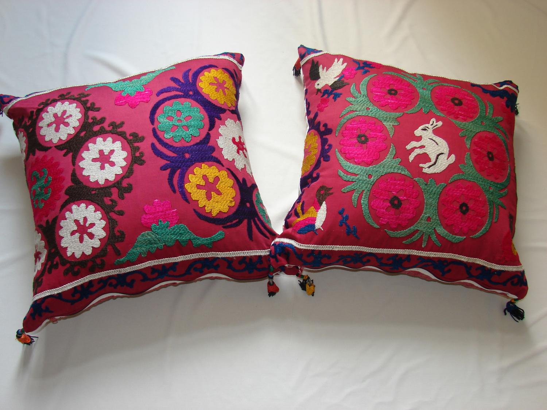 A pair of Suzani cushions c1960