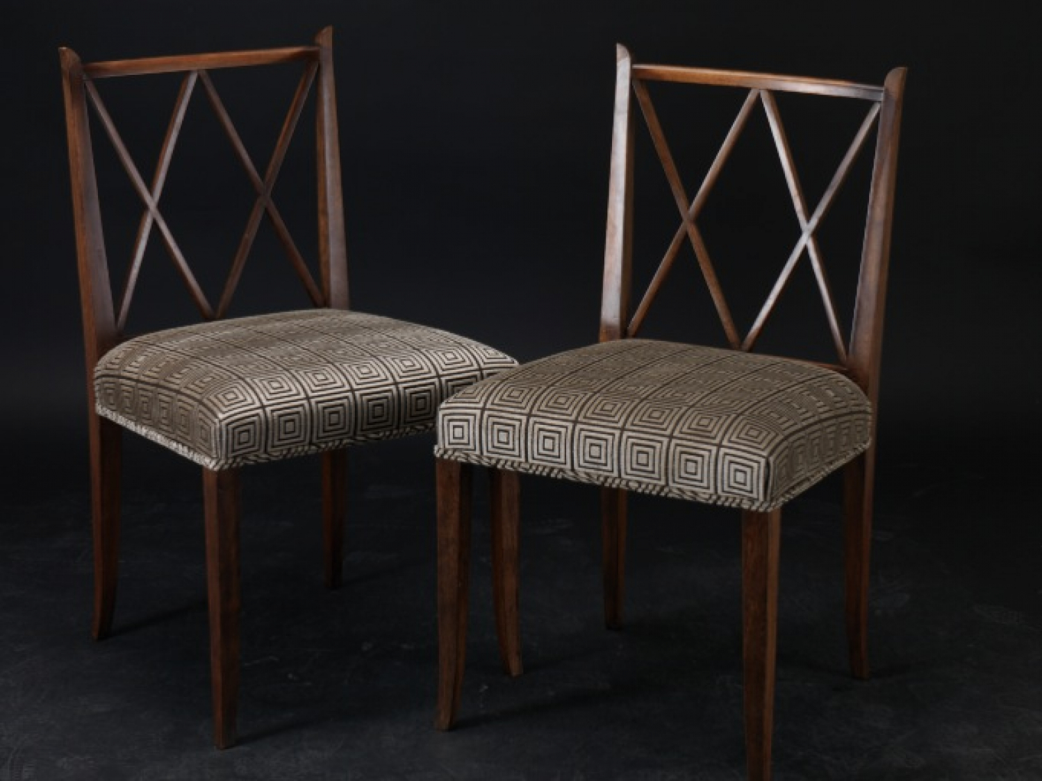 Four walnut Dining Chairs designed by Tommi Parzinger 1946