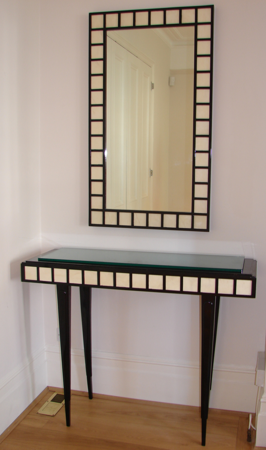 Ebony and parchement console table and mirror