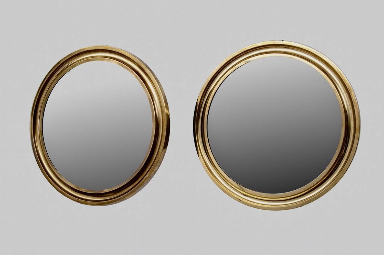 Pair of round brass mirrors
