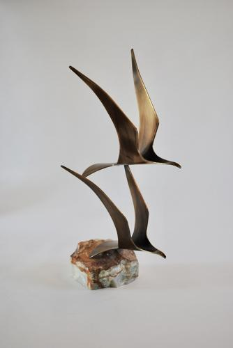 Sculpture of seagulls in flight