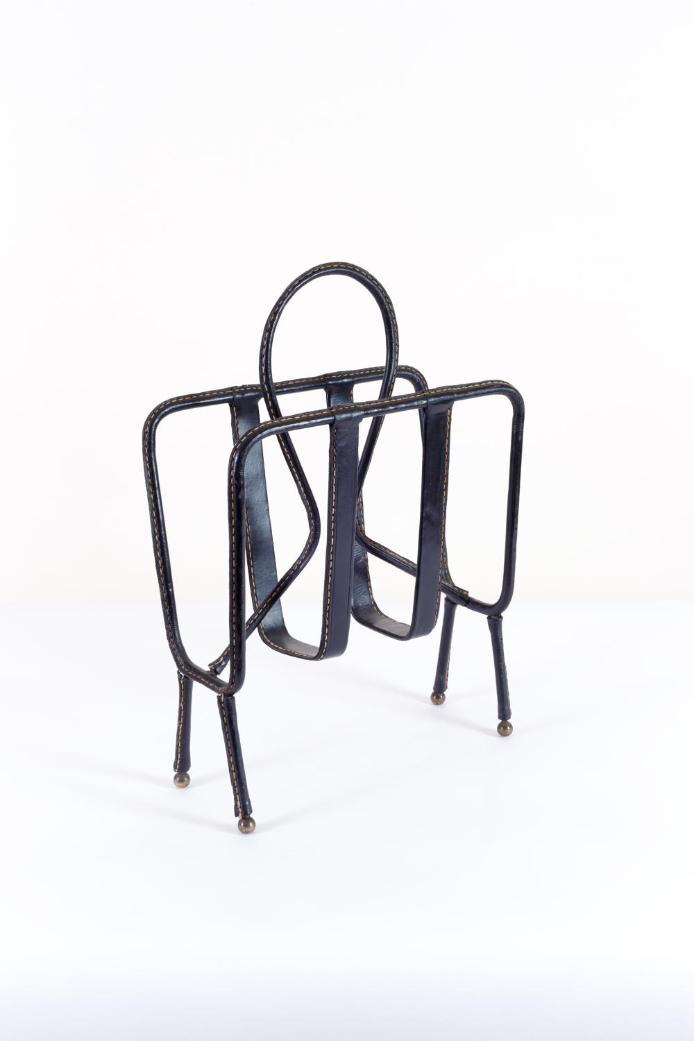 Magazine rack in stitched black leather