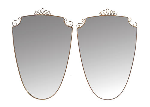 Pair of shield shaped brass mirrors