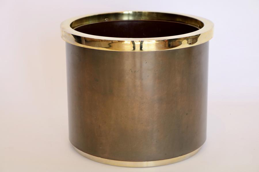 Brass and lacquered metal plant pot holder